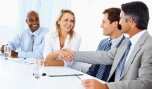 Cheerful woman setting a deal with male executive